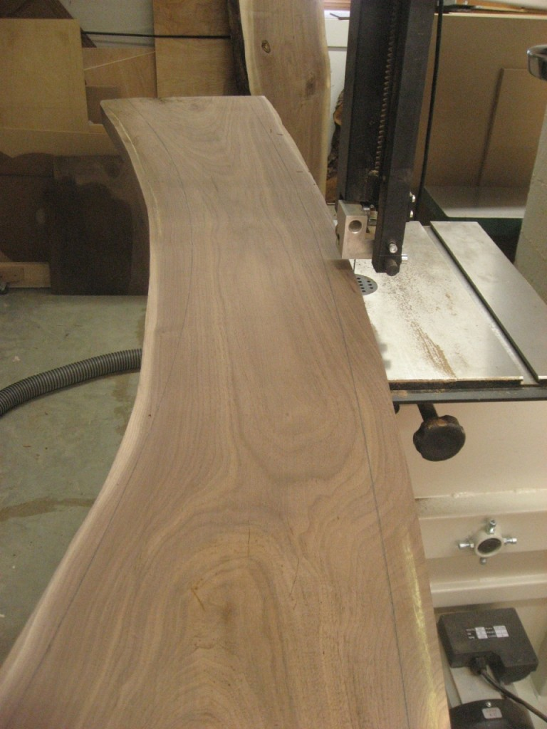 The bandsaw quickly removes the waste beyond the traced curves.