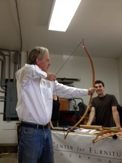 Tom Lie-Nielsen trying out one of the bows made by a student at the Center for Furniture Craftmanship.